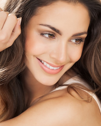 Restorative Dentistry Oviedo - Beautiful woman showing how good fillings are
