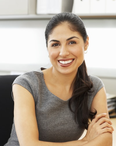 Restorative Dentistry Oviedo - Woman smiling after a root canal